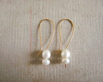 f2c45c1c7 White dangle pearl Earrings, Gold plated copper. Cultured fresh water  pearls. Long white earrings. Hand made shaped earrings.