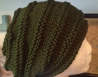 Dark green colored semi slouchy knit hat