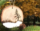 Wood slice Christmas Ornament, wood burned tree on snow field - Put an ornament made from a tree on your tree