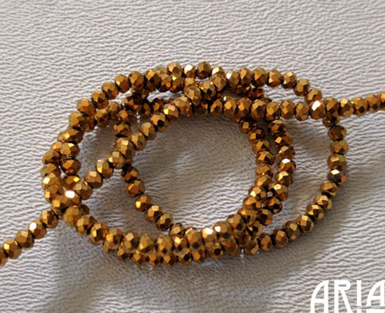 BRONZE GOLD: 1x2mm Faceted Glass Rondelle Strand 195 beads image 0