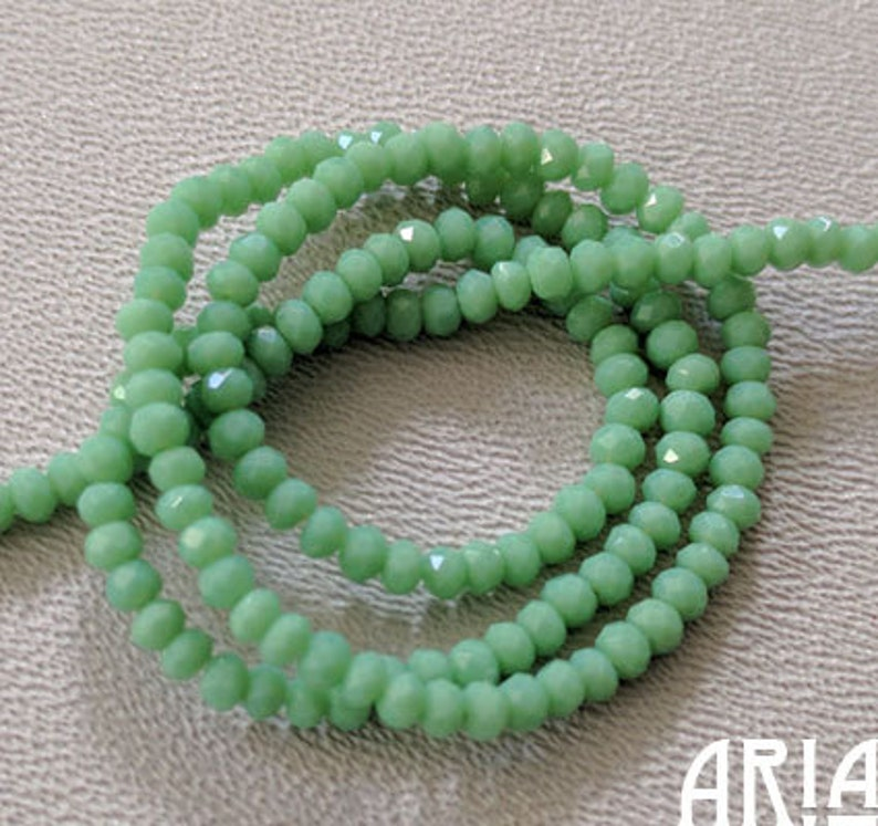 GREEN OPAL: 1x2mm Faceted Glass Rondelle Strand 195 beads per image 0