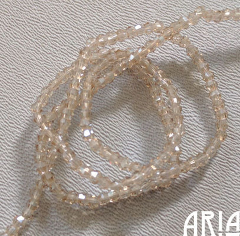 CHAMPAGNE LUSTER: 2mm Faceted Glass Bicone Strand 195 beads image 0