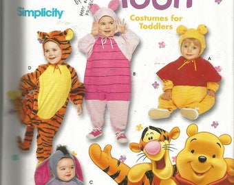 Eeyore costume etsy winnie the pooh toddlers pooh tigger eeyore and piglet costume pattern sizes 12 1 2 3 4 pattern is uncut and factory folded solutioingenieria Images