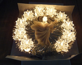 Vintage CHRISTMAS TREE TOPPER.  In great working condition..In originla box.  Silver with white lights and white angel in the middle..