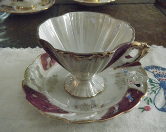 VINTAGE CUP and SAUCER Fluted cup with Footed Lace Saucer.  Burgandy/purple and White Lustre with gold trim.  Very unique