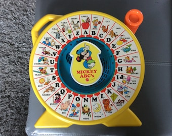 Vintage Mattel SEE N SAY Mickey's ABC,s .  1989 collectable Mattel.  In good worki g condition.  Hours of old fashion fun for toddler