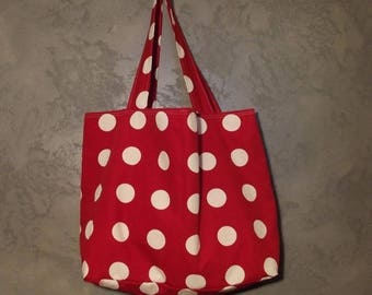 Red and white reversible tote.