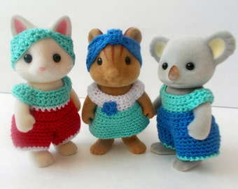 PDF Crochet Patterns for Momma Critter.  File includes patterns for a jumper, dress, headpiece and some embellishments.