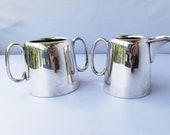 Two STERLING SILVER cups with silver markings baby cup creamer matching set of antique silver cups with markings double handled