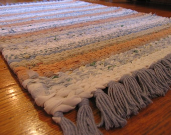 Hand Twined Rag Rug in blues, tans and whites with Hand Tied Matching Fringe.  (Free Shipping)