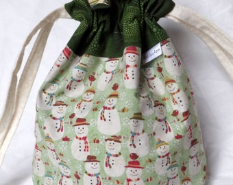 Snowpeople in Hats and Mittens drawstring bag with cotton fabric ties for knitting & craft projects (small - green)