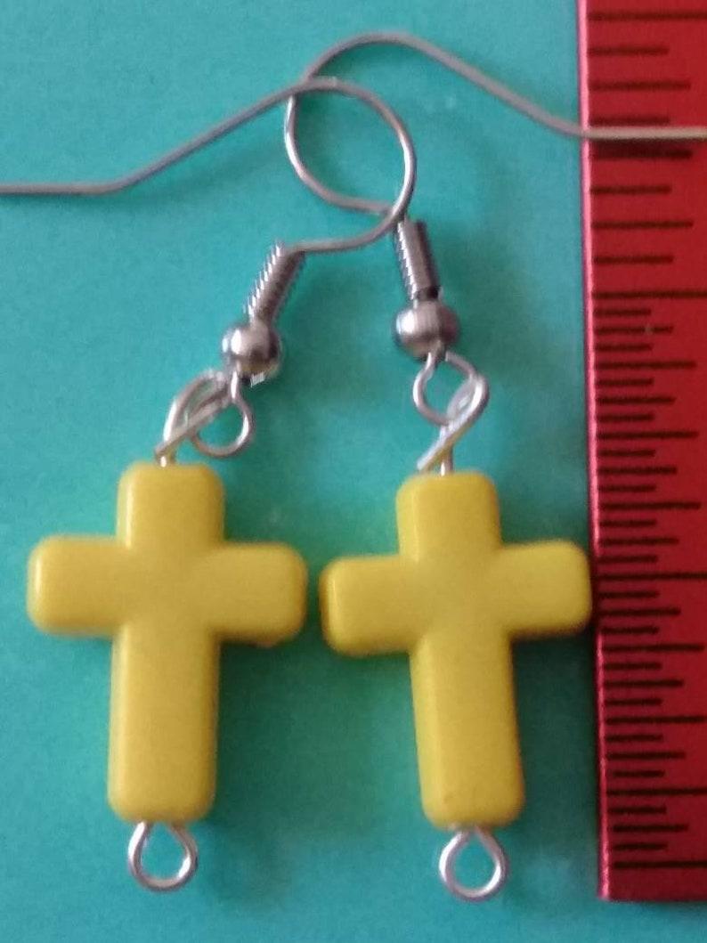 Yellow plastic cross earrings