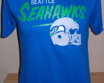 vintage 1980s Seattle Seahawks foorball t shirt Medium 50 50 Writing on Back 8f236a00a