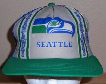 ae08273ca90 Vintage 1980s Seattle Seahawks football green and blue snapback trucker hat  NFL