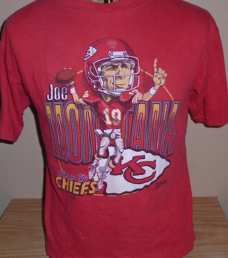 new style e3bf2 5ea67 Vintage 1990s Kansas City Chiefs Joe Montana t shirt youth 14-16