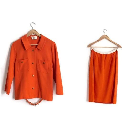 70s Orange suit. Bright orange skirt and jacket tw