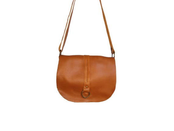 babd4d02ea Brown suede crossbody bag with braid and tassel