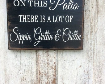 On this Patio there is a lot of Sippin, Grillin & Chillin, father's Day sign, patio Sign, wood sign