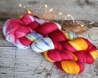 Hand dyed speckled sock yarn Merino nylon blend superwash, Spring Roll