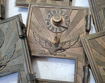 ONE Vintage brass Eagle Post office box door and frame , NO Glass , PO box door opens , combination unknown