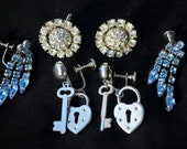 Three sets of vintage screw back earrings. Blue dangly rhinestone, flower rhinestone and kitsch heart and key earrings.