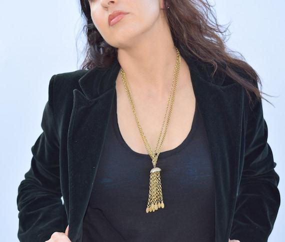 Vintage gold tone chain link tassle necklace. Mul… - image 1