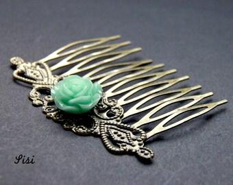 Bronze metal comb blue flower