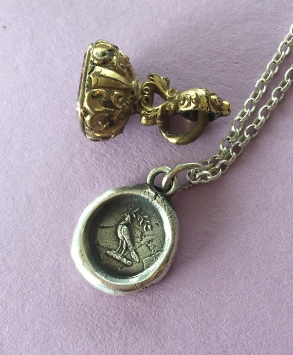 Peace.... Dove with olive branch.   Wax seal impression, sterling silver, antique image, heart and crown.