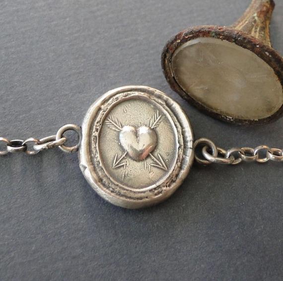 Lovestruck bracelet.. antique wax latter seal impression, sterling silver, various lengths.