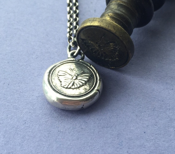 Moth.... Rebirth and new beginnings.  Sterling silver antique wax letter seal pendant.