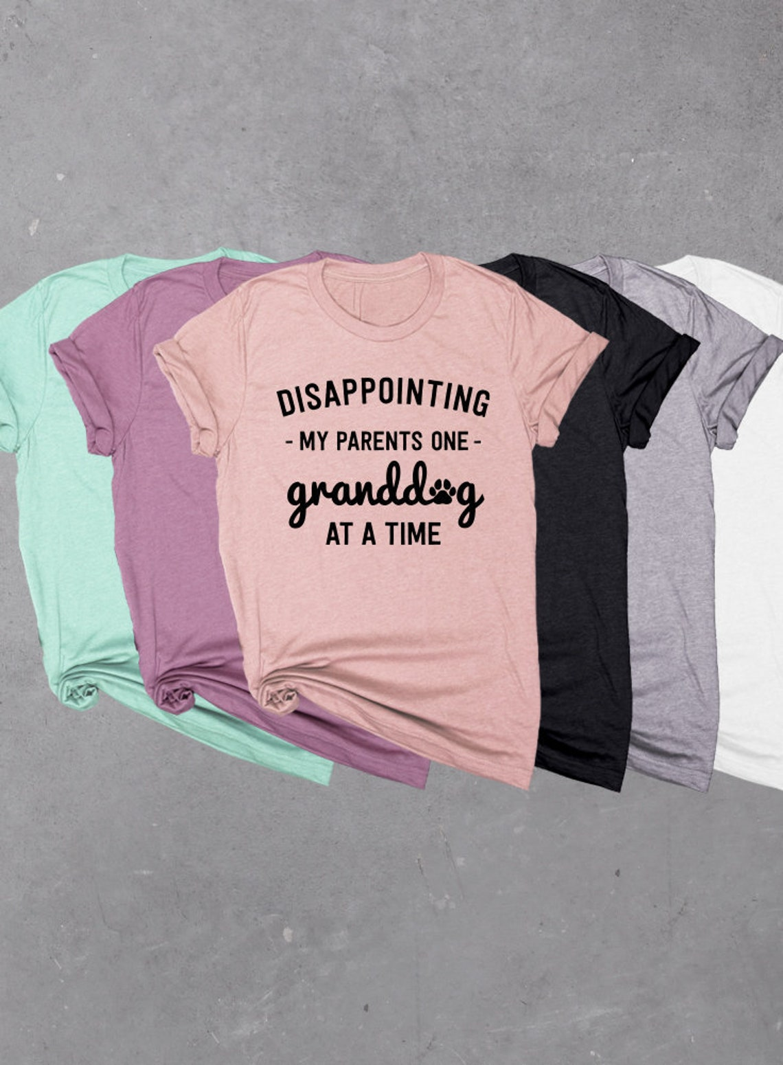 "Graphic T-Shirt with the words ""Disappointing My Parents One Granddog At A Time""."
