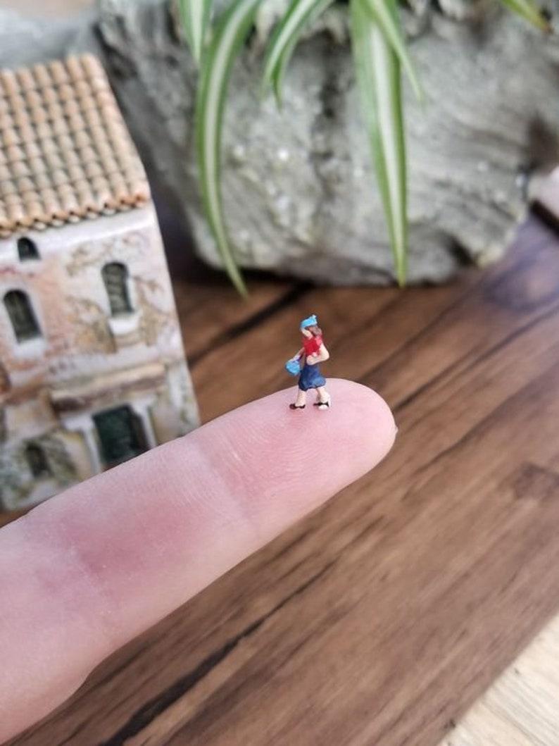 small micro miniature plastic lady figure diorama or glass ball terrarium  or miniature dome jewelry glass ball filler