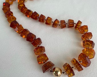 Trapezoid Bernstein Amber, hand knotted 12 to 16 mm Bernstein Amber, Swarovski crystal with 14 k gold filled findings and toggle.