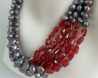 Grey Pearls Red Zircon, hand knotted in silk thread, five strands of fresh water grey pearls, hand cut red zircon with sterling silver clasp