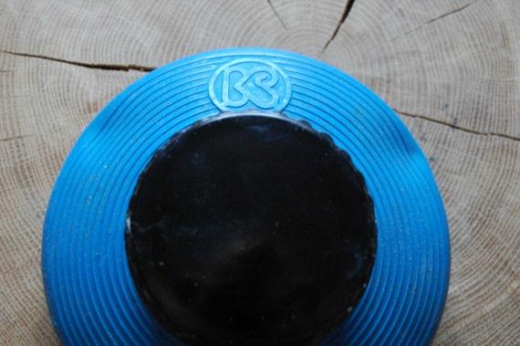 Vintage hot water bottle. Rubber warming bottle with round shape, Rubber hot water bottle with screw top, Blue rubber cooling water bottle