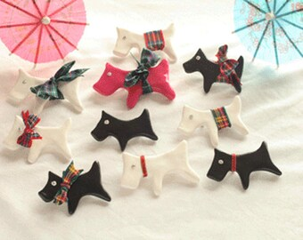 Wee Scottie Dog brooches...can be clothed in a tartan collar.