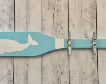 Nautical towel rack with dock cleat hooks and whale on wooden boat oar