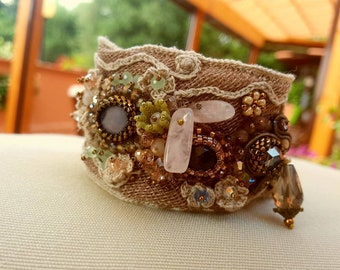 Boho chic Embroidery cuff, Band bracelet in fabric embroidered with beads and mother of pearl, with flowers and crochet trim. #madeintuscany