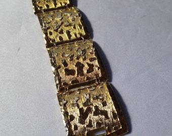 Goldtone Bracelet. 7 inch by 1 1/8 inch.