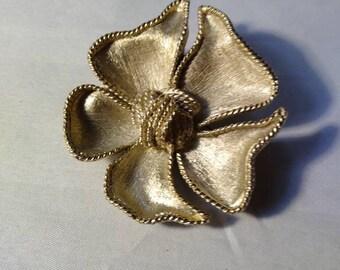 Floral Motif Brooch. Goldtone Metal. 2 inch diameter.