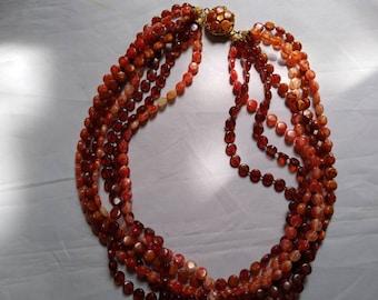 Vintage Orange to Rust 7 Strand Plastic Bead Necklace.