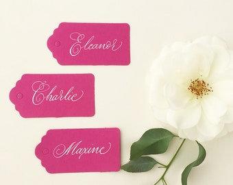 Fuchsia pink wedding luggage tags with hand calligraphy in white ink / escort tags / place cards / personalised name tags for weddings