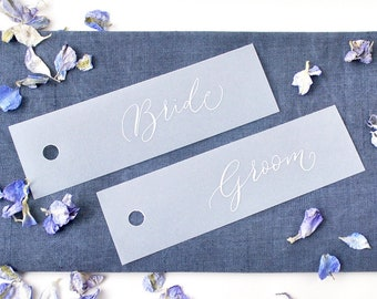 Elegant wedding place names - quality vellum paper with white handwritten calligraphy, punched hole