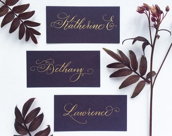 Dark purple wedding place names with hand calligraphy in gold ink / escort cards / place cards / personalised name cards for weddings