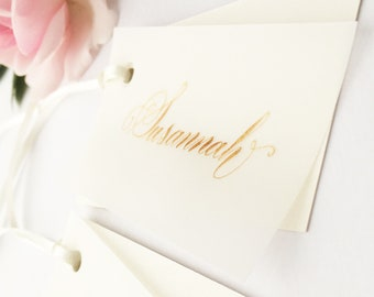 Calligraphy wedding place names with sheer overlay and gold ink - off white place names - ivory place cards - handwritten place settings