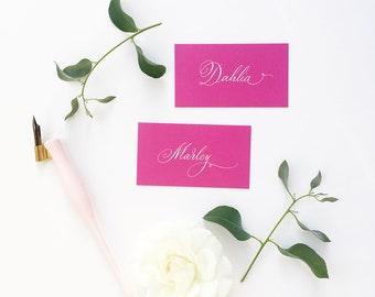 Fuchsia pink wedding place names with hand calligraphy in white ink / escort cards / place cards / personalised name cards for weddings