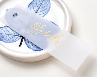 Elegant wedding place names - quality vellum paper with gold handwritten calligraphy, punched hole