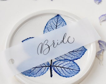 Elegant wedding place names - quality vellum paper with black handwritten calligraphy, punched hole