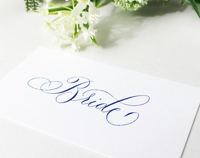 Featured listing image: Luxe white wedding place names with hand calligraphy in colour ink / escort cards / place cards / personalised name cards for weddings