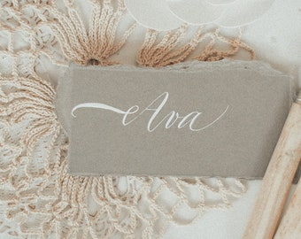 Dove grey place name with white handwritten calligraphy